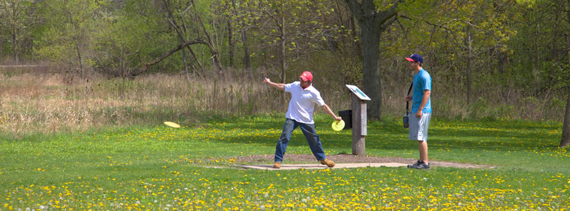 Students enjoying the disc golf course