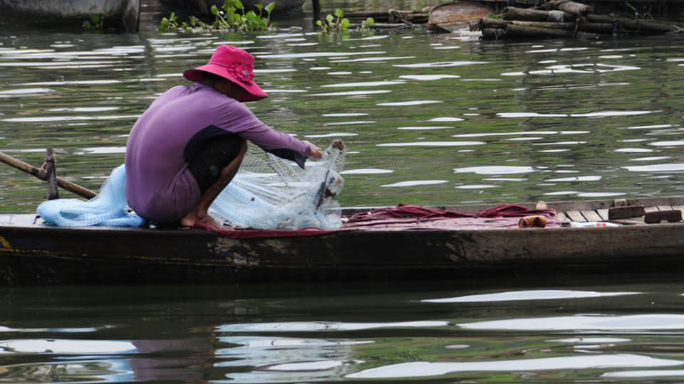 image of woman on boat in Asia
