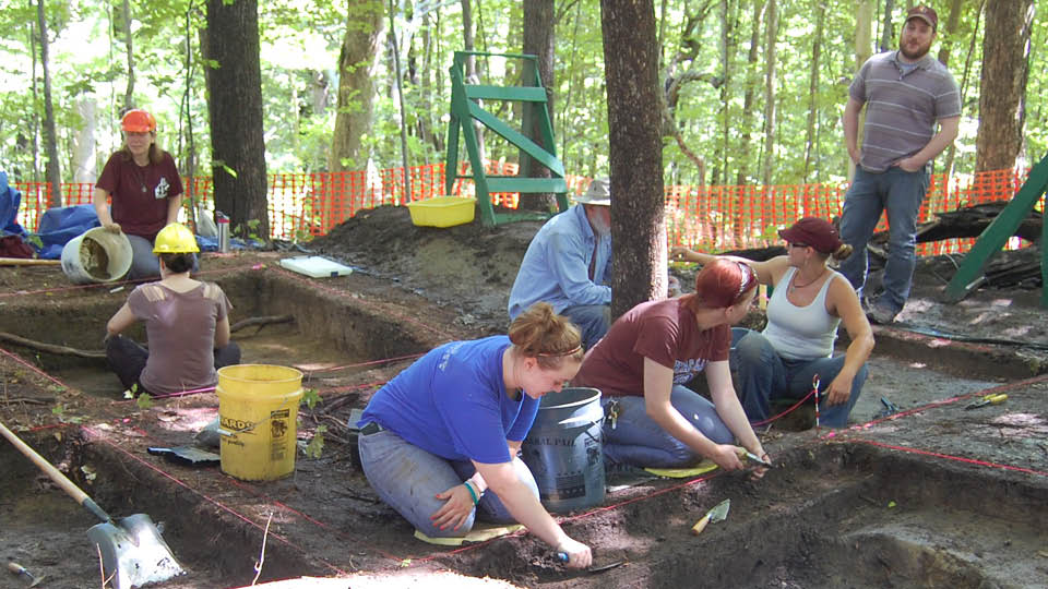 Image of student's working on a digging site