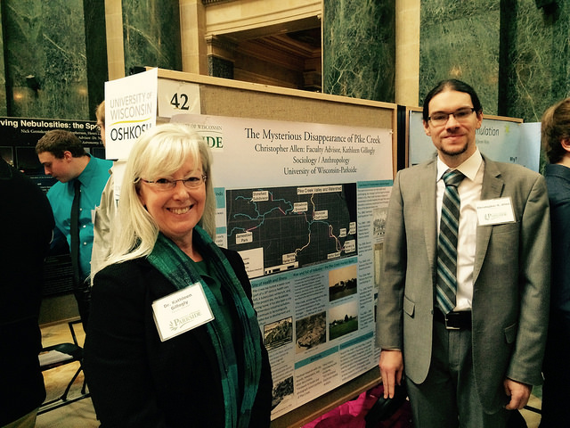 Professor Kate Gillogly and student Christopher Allen at Posterd in the Rotunda