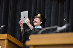 Chancellor Ford photographs graduates