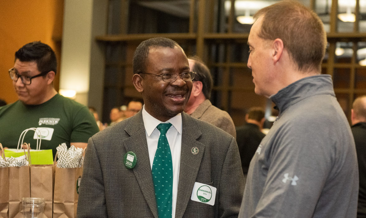 Emmanuel Otu, dean of the College of Natural and Health Sciences, and Jeff Werwie '79