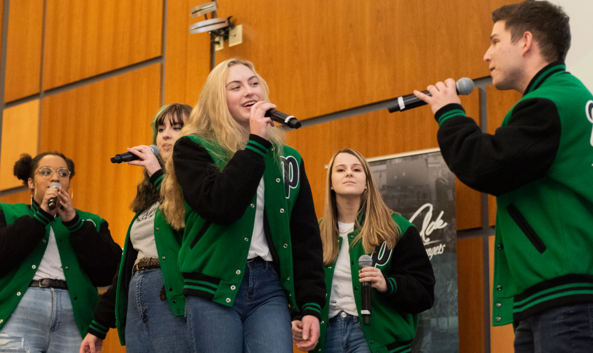 The Parkside Range, a student a cappella performance group, performs at the Ranger Romp.