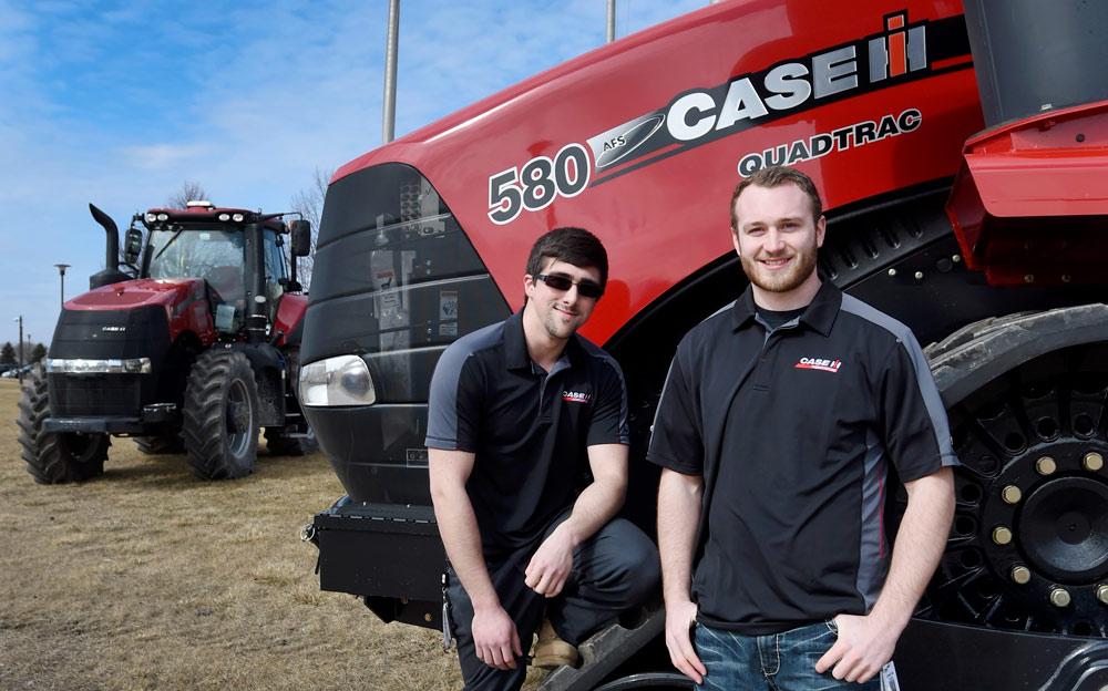 Students in front of Case tractors. Photo courtesy of The Journal Times