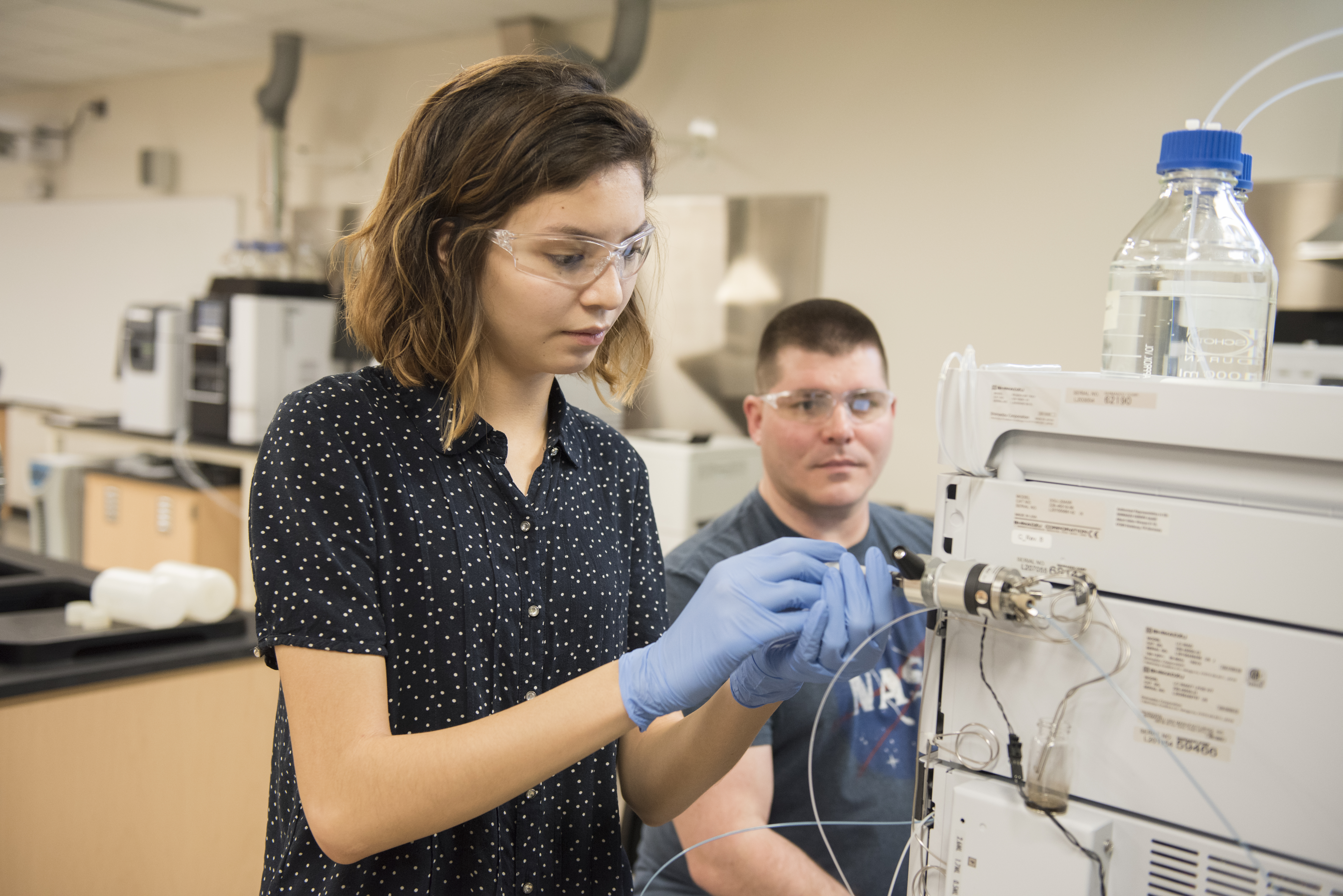 A male and female student working on new instruments in SCJ science lab