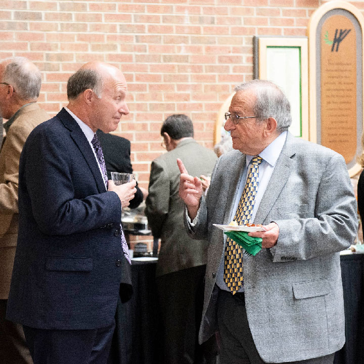 Craig Young '76 and Emeritus Professor of Computer Science & Engineering Dr. George Perdikaris.