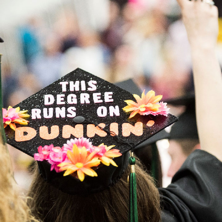 Mortar board that reads - This degree runs on Dunkin
