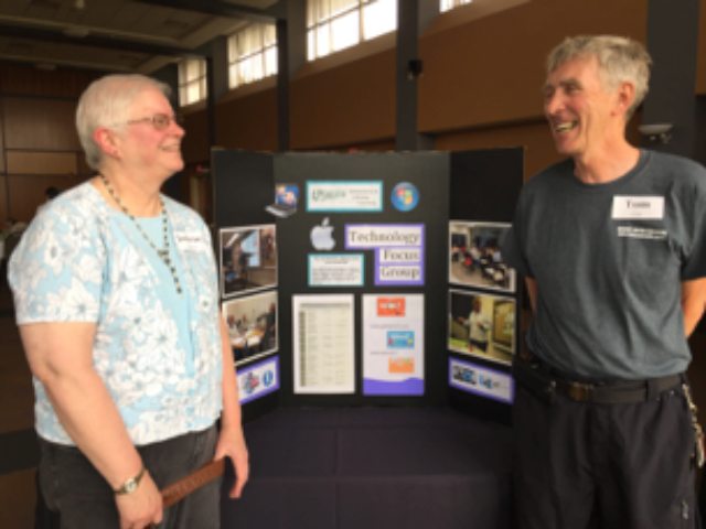 Leaders of the Technology focus group at ALL's annual meeting, displaying information about the tech review meetings, attended by about 30 people each month.