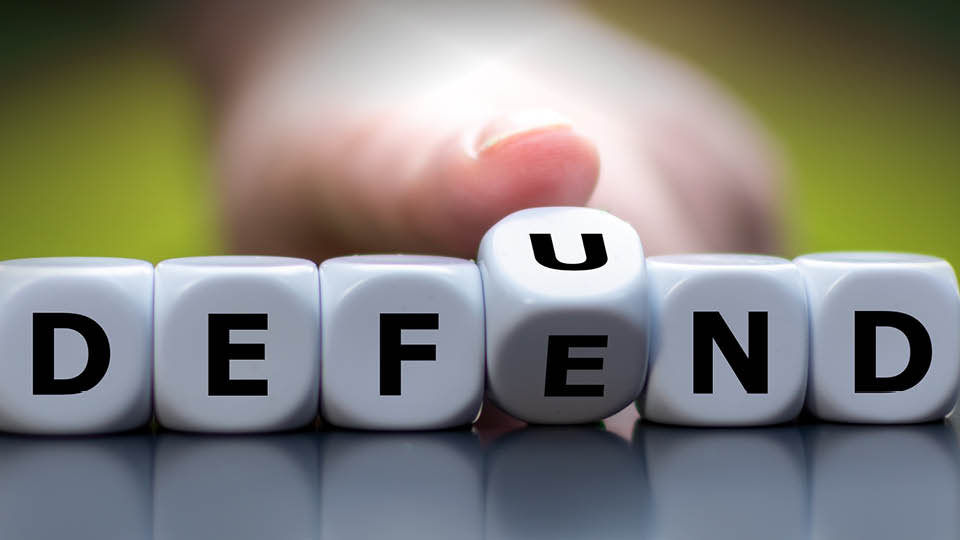 image of dice with defend/defund
