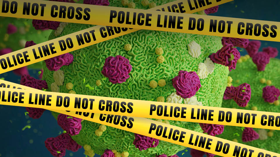 image of the corona virus with police tape in front of