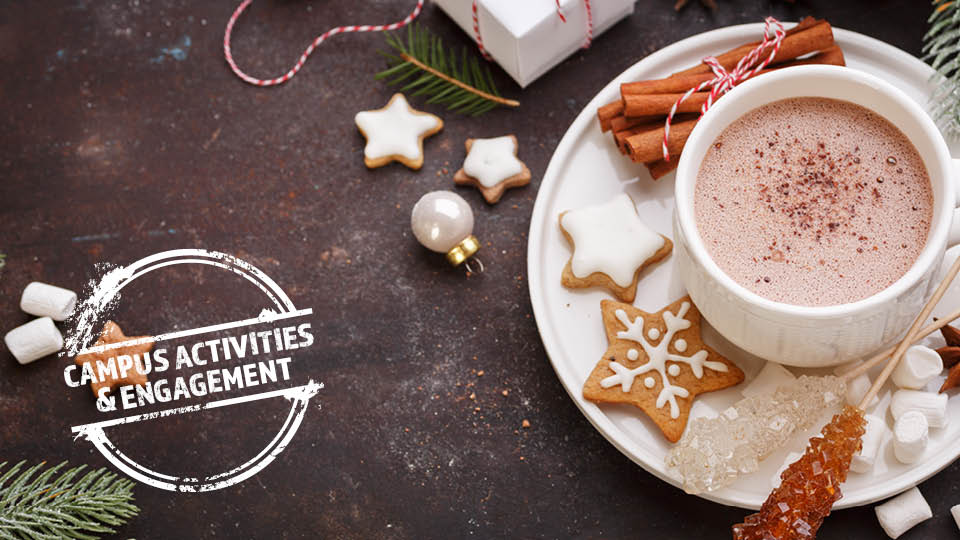 table with hot coco and holiday cookies