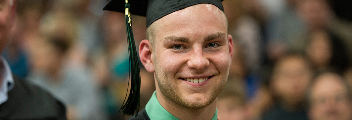 Jake Hansen at commencement - wide image