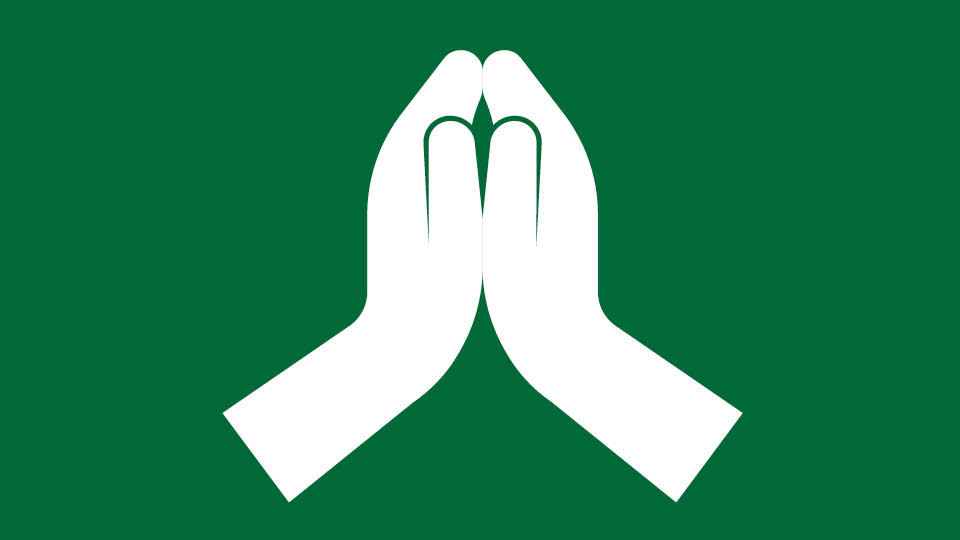white icon on green background meditation hands