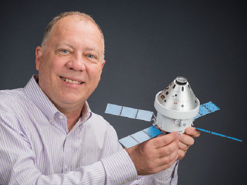 Daryl Sauer with model satellite