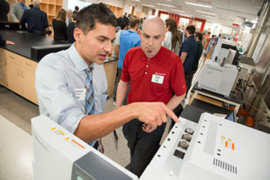 Carmine Savaglio, SC Johnson senior research scientist and UW-Parkside graduate, reviews Shimadzu instrumentation with Shimadzu Field Service Engineer David Hobbs