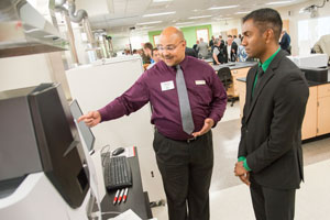 Siva Shankar of Kenosha talks with Shimadzu Engineer Delano Turner
