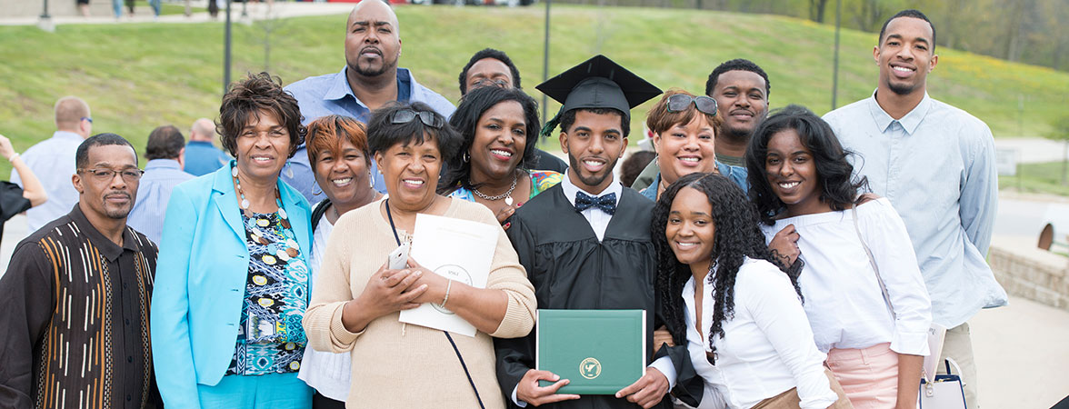 Quentin Lewis with family at commencement - wide