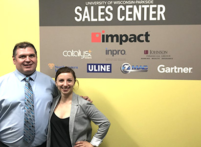image of two sales team students