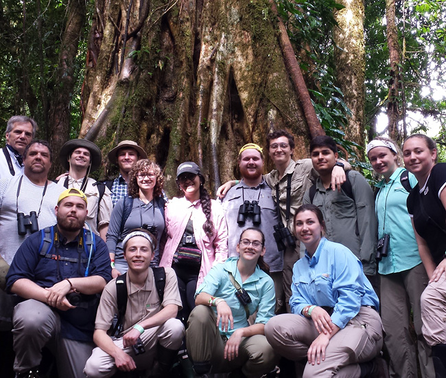 Parkside's young naturalists (and a couple of old ones) in front of a strangler fig in the cloud forest at Monteverde Cloud Forest Reserve.