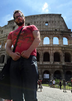Jay in Italy in front of the colliseum