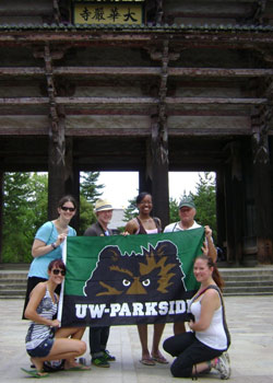 students with a Parkside banner in Japan